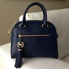 """Host Pick👠MK Satchel Selling my MK Tassel. Blue Navy color. Perfect for everyday use. Not too small/big, with back security pocket. Inside has 1 phone slot, 3 addtl pockets & 1 security pocket. No dustbag. Strap Drop: double handle 3"""" detachable shoulder 21"""". Priced to sell... Michael Kors Bags Satchels"""