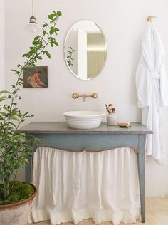French Cottage Powder Room Features A Blue Skirted Sink Vanity Topped With A Round Bowl Sink Tucked Un Patina Farm Shabby Chic Bathroom French Country Bathroom