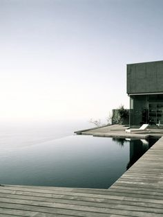 Infinity pool, wooden floor.