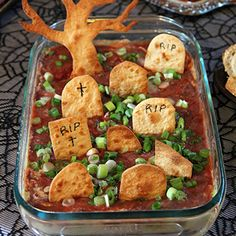 Need a spooky and fun Halloween recipe? How about graveyard taco dip with gravestone tortilla chips! This recipe is just as simple to make as it is cute.