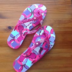 Coach flip flops. So cute Pair of never worn pink flip flops size 6 . These have flowers and the word coach on the band. They have scrapes across the top part which is covered by your foot( see close up pic 3 ) Coach Shoes
