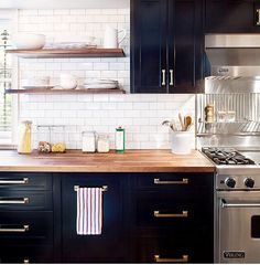 Butcher Block and Dark Base cabinets W/Light Above - subway tile