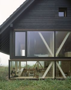 "cubebreaker: ""Zurich-based architect Pascal Flammer designed this timber house in Balsthal, Switzerland, which is sunken with ground-level wrap around windows, connecting it with nature. Design Exterior, Interior And Exterior, Exterior Siding, Interior Ideas, Timber House, Minimalist Decor, Minimalist Kitchen, Minimalist Interior, Minimalist Living"