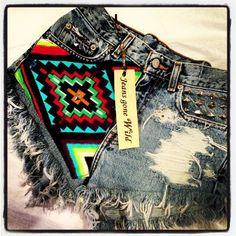 High waist destroyed denim shorts super frayed with tribal motif size Sm/Med/Lg.