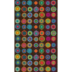 Monta värikästä pannulappua koristaa tätä iloista Marimekon Lappuliisa-kangasta. Suunnittelija Maija Louekari.