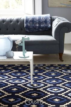 Origins weaves together moody hues of black and blue. One hundred percent wool this unique design adds an international flair to your décor.