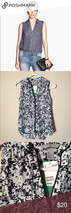 H&M Conscious sleeveless blouse Same style but not the same pattern as the first pic. Sort of a white/gray/black speckled pattern. Breast pockets. H&M Tops Blouses