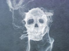 Skull - it could be smoke, dry ice has this smoky appearance or it could be spooooky!!