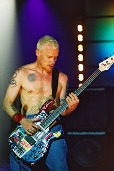 Flea - reminds me not to take things to seriously! love the chili peppers as well!