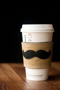 My friend makes these!  Check them out!    Mustache European Linen Inca Coffee Cup Cozy by LittleGBoutique, $12.00