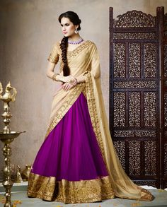 Purple Lehenga with Heavy borders 1. Purple net lehenga with contrast dupatta. Heavy golden border on lehenga and dupatta2. Comes with a matching unstitched blouse3. Can be stitched upto size 42 inches