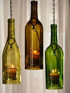 Repurposed wine bottle hanging candle lanterns: