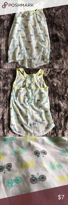 """Women's bicycle hi-lo racerback top boho summer Womens size Medium whimsical boho bicycle print racerback tank top. It has ruffles on front and back. It is blue, green and white. Great top for festivals or summer! In excellent condition! Length front-24"""" length back-27"""" armpit to armpit-18"""" Candie's Tops Tank Tops"""