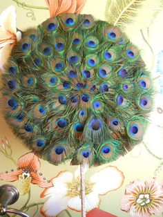 Peacock Feather Fan or I thought this would be cute for an umbrella as well!