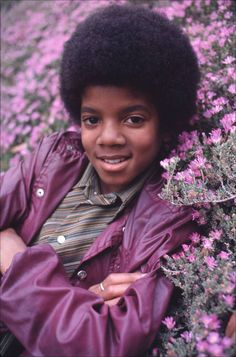 Michael Jackson surrounded by flower...<3