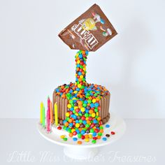 M&Ms Anti Gravity Illusion Cake: Layers of chocolate mud cake filled with Oreo buttercream covered in milk chocolate ganache frosting. Smothered in M and Ms and surrounded by chocolate finger biscuits and Malteasers. The 7 year old Birthday Girl loved it! Chocolate Finger Cake, Chocolate Mud Cake, Chocolate Ganache Frosting, Oreo Buttercream, Birthday Cake Pops, Birthday Cake Girls, Birthday Ideas, Gravity Cake, Beautiful Birthday Cakes