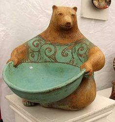 Interesting idea - the bear wouldn't work for me, but I like the idea of a clay piece holding a dish as a holder - might have to keep this in mind - repin work of Margaret Wozniak (upcycle dishes)