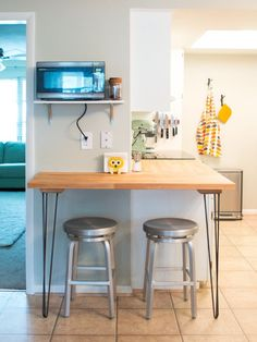 Hairpin legs can be used in this kitchen too! Loving this built kitchen bar with hairpin legs.