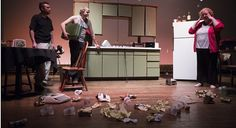 """Mom, played by Maggie Allen, pulls her hands to her head as she comes to witness her kitchen trashed with beer cans and other messes created by her sons Austin, left, and Lee, played by Chris Roady and Derek Trautwein, during a dress rehearsal for Sam Shepard's """"True West"""" on Tuesday, June 2, 2015, at Liberty Hall."""