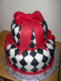 """10"""" and 6"""" cakes covered & decorated in fondant."""