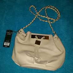 Olivia + Joy Selene Collection crossbody. Brand new/never used! Very cute leather beige/tan cross body satchel. Long gold chain strap. Zippered pocket and two other pockets inside. Fits any wallet or phone inside! Olivia + Joy Bags Crossbody Bags