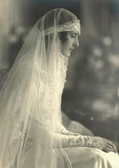 vintage wedding gown- like the head piece and veil togethet