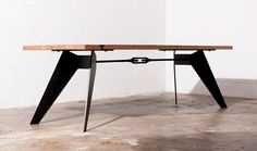 Mr Rhondes industrial dining table featuring angled metal legs and a turn buckle feature. This table was designed and made by Zeele.