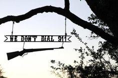 Redneck no trespassing sign.