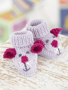 Bootees from Little Treasures (490) - 17 gorgeous handknits for boys and girls from birth to 7 years knitted in Sirdar Baby Bamboo DK which are full of loveable character and charm. We have trendy little knits, such as the alpine inspired cardies and hats for girls and the textured wrap neck sweaters for boys | English Yarns