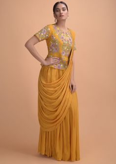 Buy Rani Pink Indowestern Gown With Embellished Drape And Extended Floor Length Sleeve Online - Kalki Fashion Designer Bridal Lehenga, Bridal Lehenga Choli, Designer Gowns, Indian Designer Wear, Yellow Gown, Yellow Lehenga, Yellow Suit, Indowestern Gowns, Gown Party Wear