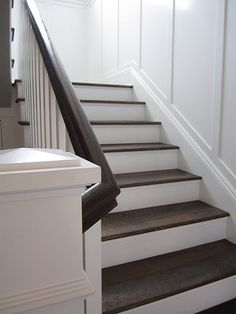 Reclaimed wood treads, white risers, and wainscot. Yum.