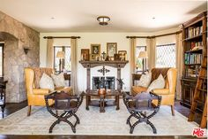 The wooden accents throughout the home add to the home's structural old world feel, crosses adorn the fire place Malibu Mansion, Stone Archway, Mel Gibson, Old World, Property For Sale, Medieval, Real Estate, Bedroom, David Duchovny