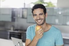 Man with apple eats a good diet. - Astronaut Images / Getty Images