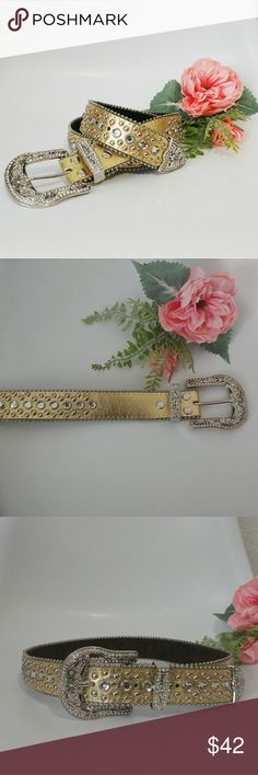 "Gold/Silver Studded Rhinestone Leather Belt This embellished western belt is in excellent condition! The studded rhinestones and floral silver buckle make this a most have accessory. Tagged size small. Looks to be 80-90s vintage but I'm not positive.  Fits 29-33"" waist Width: 1.5"" Accessories Belts"