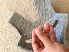 Bend the paperclips to shape and then glue them into the cut