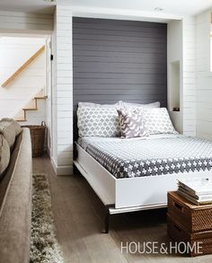 This Murphy bed uses a suspension system that makes it possible to lift with one finger. On both sides of the queen-size bed, a niche in the wall acts as a side table and is wired with a reading light. Cottagey Basement Bedroom | House & Home