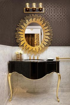 HGTV presents an Austin-based boutique that exudes art deco style blended with c. HGTV presents an Austin-based boutique that exudes art deco style blended with contemporary and eclectic themes. Interior, black and gold, vanity, starburst mirror Boutique Bathroom, Gold Bad, Black And Gold Bathroom, White Vanity Bathroom, Bathroom Vanities, Bathroom Sink Cabinets, Bathroom Marble, Art Deco Bathroom, Bathroom Lighting