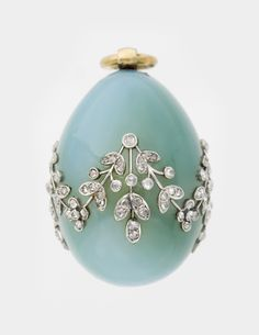 Peter Karl Fabergé (Russian, 1846-1920). 'Miniature Easter Egg Pendant' c. 1900. A floral embellishment set in diamonds, featuring a design of the Lily of the Valley flower. ~ {cwl}