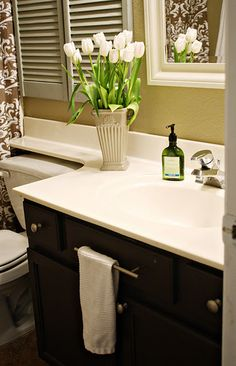 Good idea to put a towel holder on the fake drawer in the bathroom.actually adding one on the fake drawer in the kitchen! it makes sense! Upstairs Bathrooms, Guest Bath, Home Organization, Organizing, First Home, Apartment Living, Living Room, Cheap Home Decor, My Dream Home