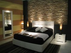 Bedroom with rock-wall