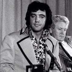 """Elvis' father, Vernon Presley, sat beside his son during the """"Madison Square Garden"""" press conference."""