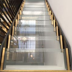 Glass and brass staircase at Vesper Hotel | Design Hunter
