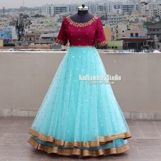 Party wear indian dresses - Gorgeous ice blue and maroon color combination floor length dress with floret lata design hand embroidery gold thread work This out fit is Available from house of Kadhambari They can customize t Party Wear Indian Dresses, Indian Gowns Dresses, Party Wear Lehenga, Dress Indian Style, Bridal Lehenga, Indian Wear, Girls Dresses, Prom Dresses, Kids Blouse Designs