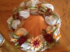 Love the flowers and leaves on the new fall burlap wreath I just made!!!