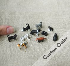Custom Miniature pet or animal, polymer clay. €7,00, via Etsy.