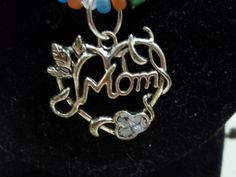 FROSTED SEED BEAD WITH MOM PENDANT