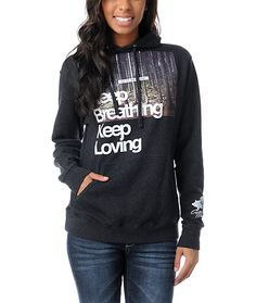 "This classic fitting girls pullover hoodie has a large graphic print on the front with ""Keep Breathing, Keep Loving"" and ""Was Lost Now I Am Found"" lettering."