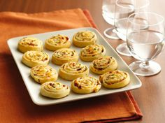 Bacon-Cheddar Pinwheels. Don't make these unless you have guests over because once you start eating them it is hard to stop!