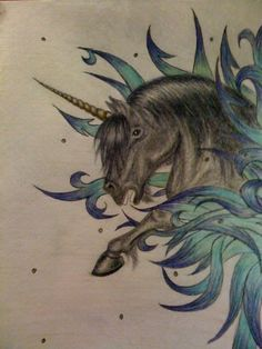 This a a black unicorn coming out from the tribal space into another dimension. It is done by pencil sketch and coloring pencils.