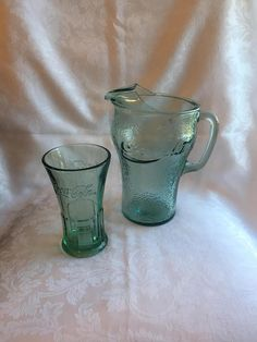 Collectible vintage glassware items advertising Coca Cola. Green tinted glass tumbler and pitcher. Tumbler is smooth glass and pitcher is a pebbled texture. Great condition! Both pieces are thick, heavy glass. Pitcher is about 9 tall and tumbler is about 6 tall.